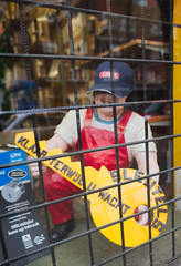 locksmith behind bars (n.a.) Tags: holland amsterdam nl netherlands sleutels yellow key locked smith maastraat deurloostraat