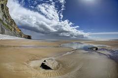 Islands on the coast (pauldunn52) Tags: monknash cwm nash glamorgan heritage coast wlaes wick beach sand rock pools clouds