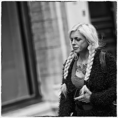 Whatever Became of Tinker Bell? (Fouquier ॐ) Tags: blonde braids tattoo hearttattoo flyinghearttattoo blondbraids longblondehair longhair hair blackandwhite street people bw