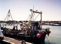 Boat with Floats (Antony J  Shepherd) Tags: littlehampton olympuspenee2 penee2 ee2 halfframe