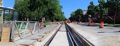 Streetcar Track Construction, North Jackson Street and East State Street (Looking North) (johndecember) Tags: milwaukee mke wisconsin usa album 2017 july summer gallery canoneosm3 canonefm22mmf2stm streetcar transit construction track milwaukeestreetcar affinityphoto software stitch mergedimages panorama sunny morning northjacksonstreet juneauvillage tower home apartment easttown street rail tracks