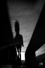in between (maekke) Tags: zürich streetphotography shadow shadows highcontrast evening bw noiretblanc man humanelement fujifilm x100t switzerland ch 2017 silhouette