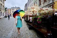 Nice girl in a rainy evening (Sphinx Qwerty) Tags: girl umbrella rain evening oldtown cafe lublin poland