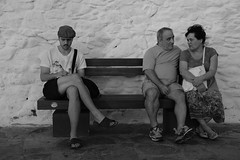 2017_0721_18324300 (chilliandrice) Tags: fuji fujifilm x pro2 35mm blackandwhite monochrome street greece greek mykonos bench three couple candid write writer hat