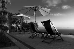 offset (pat.netwalk) Tags: terrace sunchairs umbrella calabria balass copyrightpatrickfrank dawning bildgutch blackandwhite monochrome