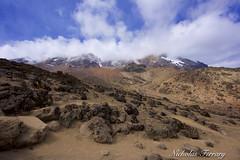 Mount Kilimanjaro Under Cover (Nicholas Ferrary) Tags: nicholasferrary nature nikon nikond800e nikon200400mmvr nikond810 d800e d810 mountain volcano kilimanjaro mountkilimanjaro mount rock lava landscape sky clouds africa africanwildlife tanzania nationalpark kilimanjaronationalpark
