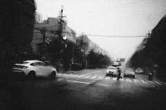 Déjà Vu (tomorca) Tags: rain umbrella car street monochrome blackandwhite people blur fujifilm xt2