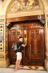 2017 SPM0192 Sam Duarte by elevator door at our hotel, Alfonso XIII hotel in Sevilla, Spain (teckman) Tags: 2017 europe hotel samuelduarte sevilla seville spain andalucía es