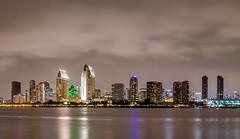 San Diego Skyline (David Youngblood) Tags: centennialpark park island coronado harbor water panorama cloudy overcast lights building landscape night city skyline sonyalpha sonya6300 ca california sandiego