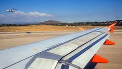 One landing & one waiting to take off (Valencia Airport) (Olympus OM-D EM1-II & Panasonic 20mm f1.7 Pancake Prime) (1 of 1) (markdbaynham) Tags: valencia airport wingtip plane olympus omd em1 em1ii em1mk2 csc mirrorless evil mft m43 panasonic lumix 20mm f17 pancake prime micro43 micro43rd m43rd