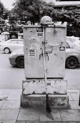 Thong Lo - Bangkok (35mm) (jcbkk1956) Tags: pentax pentaxk2 film 35mm analog ilford ilfordpan100 manualfocus street streetfurniture bangkok thailand thonglo helmet broom stickers traffic worldtrekker