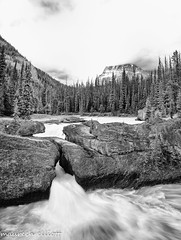 Natural Bridge in B/W (maureen.elliott) Tags: blackandwhite rockform river yohonationalpark canadianrockies kickinghorseriver rapids waterfall mountains landscape nature clouds britishcolumbia