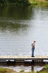Man on the lake (Vasiliy Marinka) Tags: man lake water