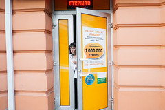 Odessa, Ukraine (f.d. walker) Tags: easterneurope europe odessa ukraine woman women door yellow orange store streetphotography street strange surreal weird face candidphotography candid color colorphotography city