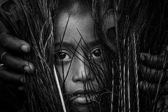 innocent face (mailmesanu20111) Tags: face people blackandwhitephotography india indian child childhood nikon creativephotography feather innocency lostchildhood imnikon nikonflickraward gettyimage imagestock dominanteyes portrait