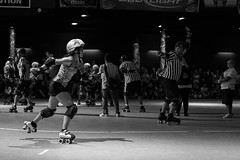 2017 Houston Roller Derby Game 6 (burnt dirt) Tags: rollerderby houstonrollerderby hrd jammer blocker pivot wftda track psychwardsirens brawlers bayoucitybosses valkyries revention reventionmusiccenter sport athlete action team competition referee penalty penaltybox helmet pads uniform houston texas downtown city town girl woman people person crowd group spectator asian latina yogapants tights leggings shorts longhair shorthair ponytail boots rollerskates skating shadow blonde brunette stockings building streetphotography documentary portrait fujifilm xt1 bw blackandwhite tattoo