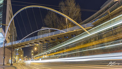 Dreaming Of A Busy Life (Tim van Zundert) Tags: manchester greatermanchester northwestengland architecture curvebridge bridge lighttrails cars bus urban city night evening longexposure sony a7r voigtlander 21mm ultron