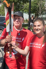 Francis King handing off to Tracie Leost (2017 Canada Games // Jeux du Canada 2017) Tags: keithlevitphotography francisking canadasummergames tor tracieleost winnpegtorchrelay