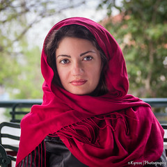 Covered with a scarf (kyrsos.) Tags: portrait young lady eyes stole scarve wraps fashion lips smile covered expression feeling attractive red bokeh scarf
