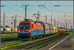1116-011-8 (Zoly060-DA) Tags: hungary taurus electric bo locomotive 6400 kw 1116 011 8 debrecen railway station freight train lines blue red white green grey yellow obb sunset