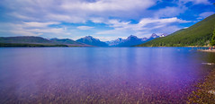 lake mcdonald in glacier national park montanaa (DigiDreamGrafix.com) Tags: park glacier national lake mcdonald glaciernationalpark lakemcdonald view reflection travel outdoors scene nature serene plant water natural tree mountain mount landscape tranquil calm pretty evening forest twilight mountains scenery usa scenic surface wild landmark peak woods reflect west wilderness terrain america international habitat parkland awesome