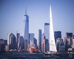 Blue and Orange (brianloganphoto) Tags: ferry skyline northamerica water newyork sailboat officebuilding skyscraper blue urban seats worldtradecenter wtc nyc newyorkcity harbor regions boat unitedstates transportation marine buildings carteret newjersey us