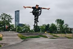 Juby's testing a new pumptrack in Wrocław. (przemyslawkrzyszczuk) Tags: sport poland polska wro wroclaw wroclove pump track bmx rower bike bicycle sky tower wiezowiec andersa park plac breslau man trick sztuczka