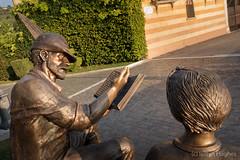 eugenio corti-09102 (www.atgof.co) Tags: eugeniocorti torri del benaco memorial statue child man book reading nationalalpiniassociation