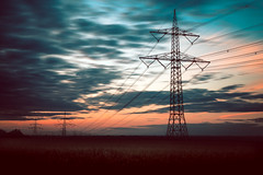 Powerful (simplyalex) Tags: fading light power lines electricity dawn sky night day lights summer field blue red colours warm nature clouds motion blur horizon germany sunset magdeburg powerful