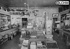 GN400 (Lane County Historical Museum) Tags: eugeneoregon lanecountyhistoricalmuseum vintage historicalphoto oregonhistory digitalcollection florist fruitmonger commercialinterior downtownbusiness citycenter shopkeepers