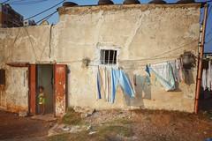The canvas she was born into~ Lebanon (~mimo~) Tags: photography child doorway shadow sunset laundry street girl tripoli lebanon