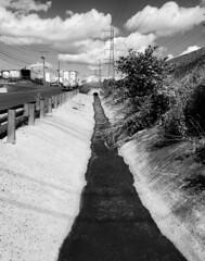 drain away (sephrocker) Tags: iphonese blackandwhite mono industrial clouds runoff truck drain