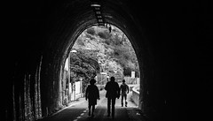 Light at the end of the tunnel (PhredKH) Tags: bonosola lavanto italy italiancoast italiantown italianriviera italia italiancoastaltown tunnel light outdoorphotography outdoor people pedestrians endofthetunnel photosbyphredkh fredkh phredkh monochrome blackandwhite blackwhite bw greyscale whiteandblack whiteblack arch ef70200mmf28lisiiusm
