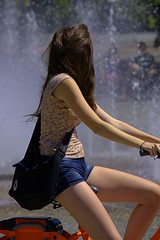 Sightseeing (swong95765) Tags: woman female lady riding bicycle fountain sightseeing shorts pretty beauty