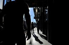 Behind the scenes (Eleni Maitou) Tags: metro metrostation athens nikon nikond90 street streetphotography backshot silhouettes streetlife shadows light man outside walkers