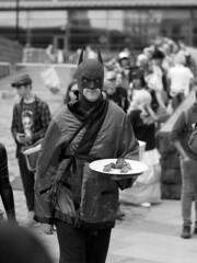 lunch time (slavamanc) Tags: batman portrait monochrome blackwhite candid funny comiccon manchester comichero man people festival city street dressup fancydress takumar