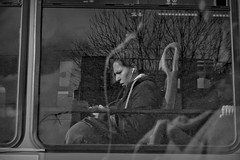 Texting in the bus (Wal Wsg) Tags: textinginthebus textoenelbus people gente argentina argentinabsas buenosaires caba capitalfederal ciudadautonoma ciudaddebuenosaires bus window byn bw blancoynegro blackandwhite canoneosrebelt3