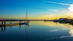 River's charm (Christie : Colour & Light Collection) Tags: fraserriver river steveston sunset sundown sunlight reflections boats sailboat richmond bc canada dock wharf pier romance romantic