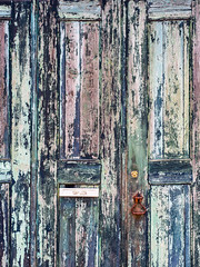 Distressed Doors (jaxxon) Tags: 2017 d610 nikond610 jaxxon jacksoncarson nikon nikkor lens nikon50mmf28g nikkor50mmf28g 50mmf28 50mm niftyfiftyprime fixed pro abstract abstraction doors paint painted peelingpaint distressed weathered decay decayed damaged urban rural ancient antique wood wooden rusty knocker rust