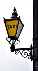 'Taxi!' (Peter Denton) Tags: street lamp taxi sign parliamentsquare london england capitalcity parliament houseofcommons houseoflords ©peterdenton cab transport transportation streetfurniture uk unitedkingdom