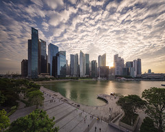 Skyline Starburst (Scintt) Tags: singapore marina bay exposure sunset light evening dramatic surreal travel urban exploration buildings cityscape city skyline architecture offices business tanjong pagar central district cbd financial jon chiang photography scintillation scintt sky clouds residential sony a7r canon 17mm tse tilt shift hotel integrated resort casino exclusive tourism shopping mall property dusk wide angle residences banks field glow orange fiery sun pano panorama stitched water starburst lens flare