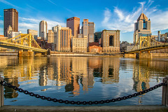 Welcome to Pittsburgh (Lee of Western PA) Tags: blue skyline city urban canon sigma sl1 pittsburgh pennsylvania allegheny pgh bridges skyscrapers reflection symmetry foreground chain