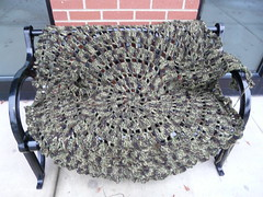 Another view of Teddy's jacket-to-be lounging with one sleeve on the arm rest of the bench (crochetbug13) Tags: crochet crocheted crocheting crochetcircle crochetcircles crochetsweater crochetjacket crochetcirclejacket dropsdesign camouflage