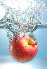 Apple drop (wickerhq) Tags: apple fruit glass liquid splash sunjuice