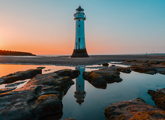 sunset on the rock (paul hitchmough new) Tags: perchrock lighthouse sunset textures water wirral reflections orange nikond800 nikonphotograhy wideangle rivermersey seaside leefilters