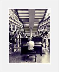 An audience (theaspiringphotographer) Tags: bw camera iphone playing london station stpancras piano