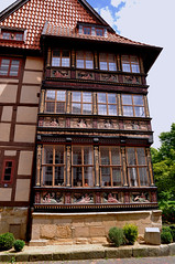Hildesheim, Niedersachsen, Wernersches Haus, west face, ground floor (groenling) Tags: hildesheim niedersachsen deutschland germany hi de wernerscheshaus fachwerk wood carving woodcarving holz house haus werner virtue tugend faith fides glaube woman frau chalice kelch cross kreuz hope spes hoffnung bird vogel anchor anker charity caritas love liebe baby kind patience patientia geduld