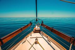 The big blue....... (Dafydd Penguin) Tags: sea water big blue sailboat sailing sail cruising yacht boat bow flat calm portugal algarve nikon d610 nikkor 20mm af f28d