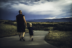 After the Storm (miss.interpretations) Tags: thunderstorm clouds skies stormy castlerock colorado meadows rainy sidewalk wet pavement concrete father sonchildren parent relationship safe love horizons canonm3 rachelbrokawphotography missinterpretations blue gold hands holdinghands fatherson