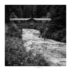 I'll wait here (paolo paccagnella) Tags: wwwphpphotographycom canonequipment bn bw blackandwhite biancoenero architecture river bridge eos5dm3 ambiente acqua activity territorio italy taa st valle aurina alpi